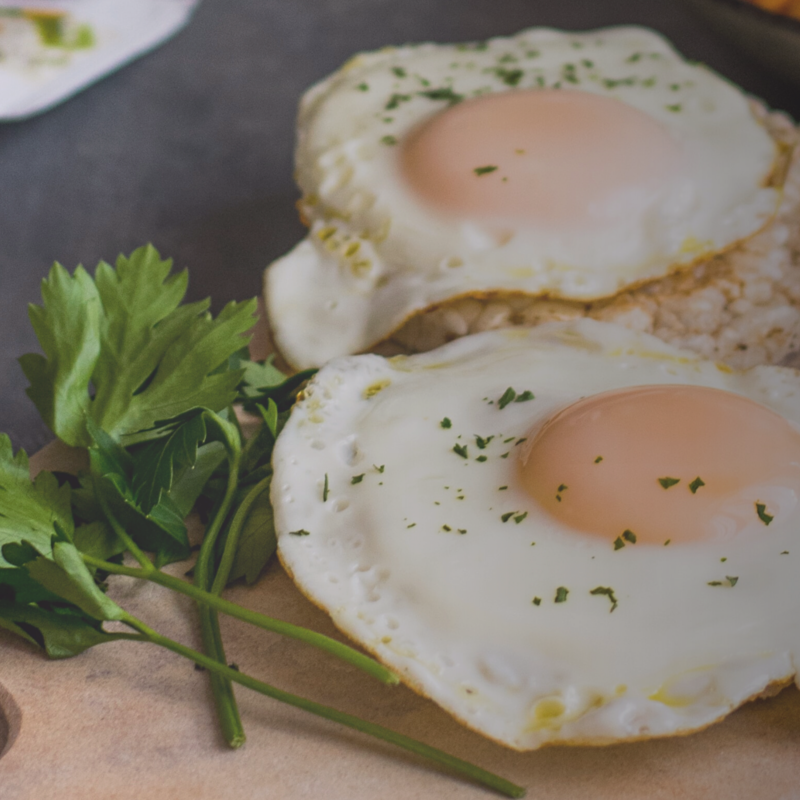 Two fried eggs with parsley.